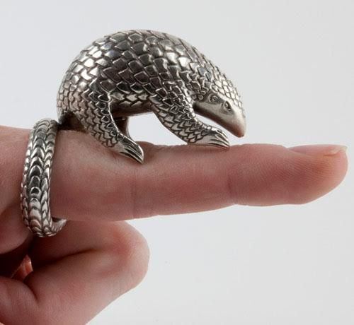 Pangolin Metal Clay Ring by Gordon Uyehara The pangolin has the unfortunate distinction of being the most trafficked animal in the world. Often referred to as scaly anteaters, these unusual mammals are hunted for their meat and tough scales that cover their bodies. Practitioners of folk medicine claim they are the cure for many human ailments. Pangolin scales are made of keratin, the same fibrous protein found in hair, horns, and nails. When threatened, a pangolin rolls itself into a ball so…