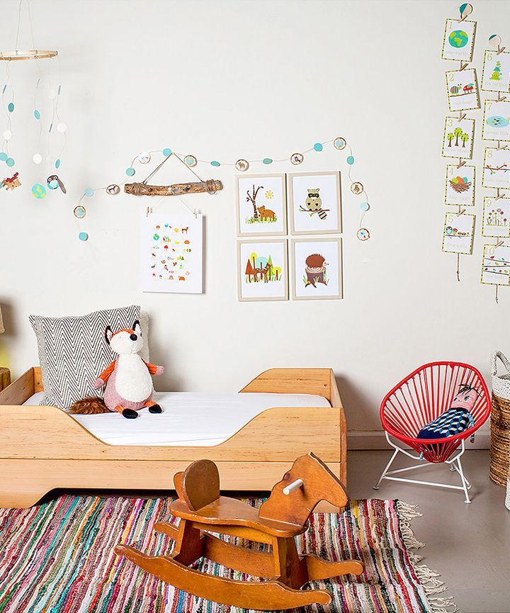 Inspire the imagination with this creative, colorful, kids bedroom + play space