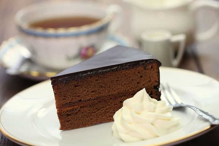 Sachertorte is a typical Austrian cake that is a base for many chocolate desserts. It is simple and easy to prepare and very delicious! Here is the recipe: Ingredients: For the Sachertorte: 7 egg yolks 150 grams (3/4 cup) butter, softened 125 grams' confectioners' sugar 250 grams' (1 cup) chopped dark chocolate 8 grams (1 packet) vanilla sugar 125 grams' crystal sugar 7 egg whites A pinch of salt 150 grams' flour Flour and butter for the mold 150 to 200 grams (3/4 cup) apricot jam Rum…