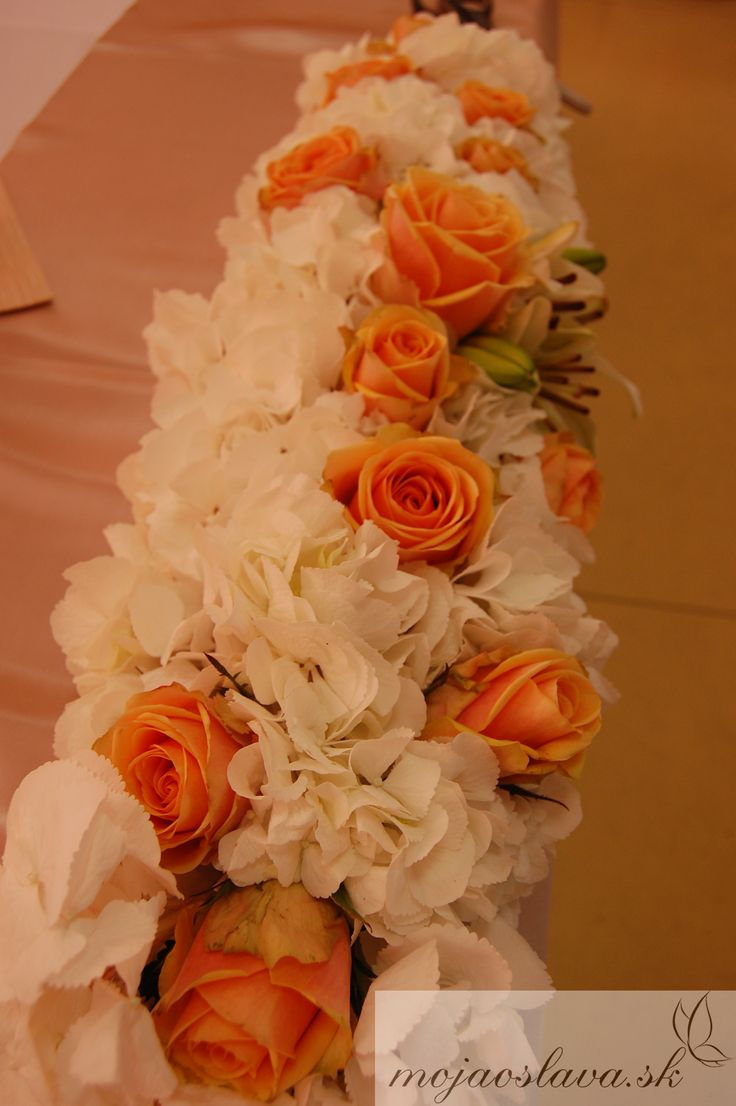 white hydrangea with peach roses and white lilium