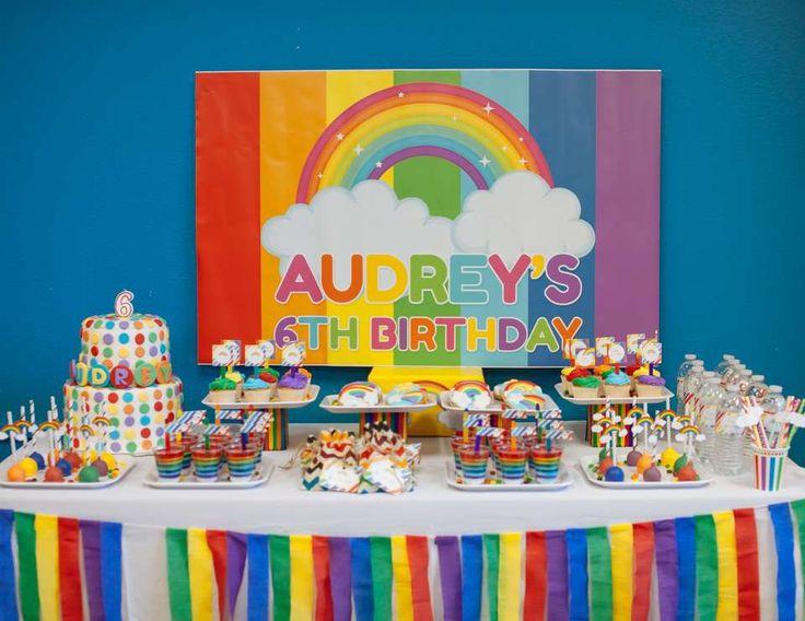 colorful rainbow birthday dessert table rainbow