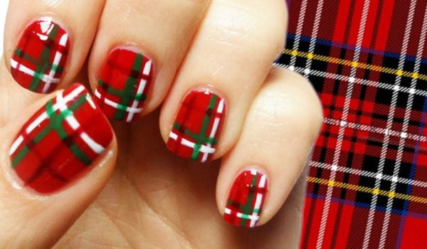 Check out this red, white and green combination. Using red as the base coat, strips of green, white and a bit of black is painted over to create a stunning plaid nail art design.