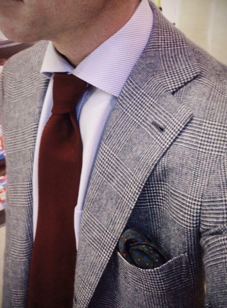 Light grey glen plaid jacket, light blue shirt, maroon tie