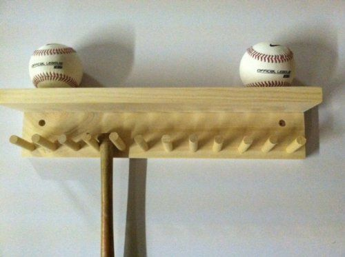 Baseball Bat Rack and Ball Holder Display Natural Finish Meant to Hold up to 11 Mini Collectible Bats and 4 Baseballs Baseballrack http://www.amazon.com/dp/B00JJWLYX2/ref=cm_sw_r_pi_dp_OmSTvb0MTVBHM