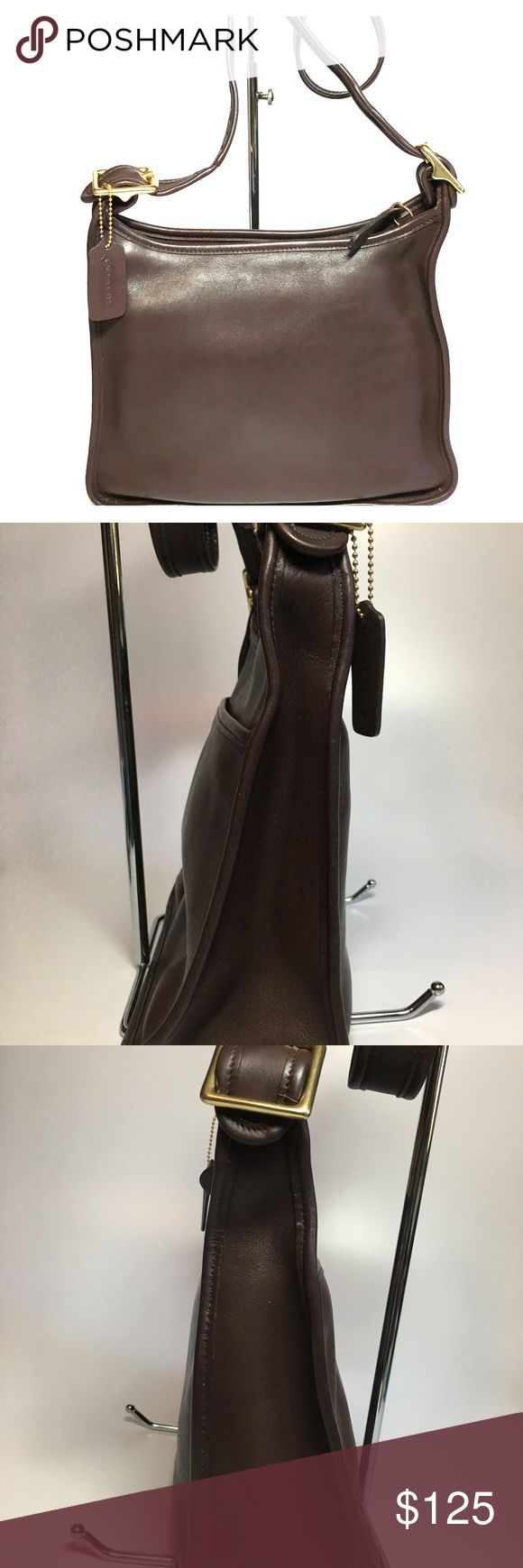 """COACH Legacy Zip Leather Crossbody Handbag 9966 100% Authentic COACH Legacy Zip Leather Handbag #9966 Color: Mahogany / Brass Size: 10 3/4"""" (L) x 9"""" (H) x 3 1/2"""" (D) Drop: 13-19"""" adjustable Made in USA Features: -In nice shape structure -In rich mahogany leather -Zipper closure -Full size exterior slip pocket -Interior with 3 small slip in pockets & 1 zipper pocket -Brass hardware -Four Brass Feet -Adjustable shoulder strap -Comes with COACH dust bag Interior: Interior is clean, no marks…"""