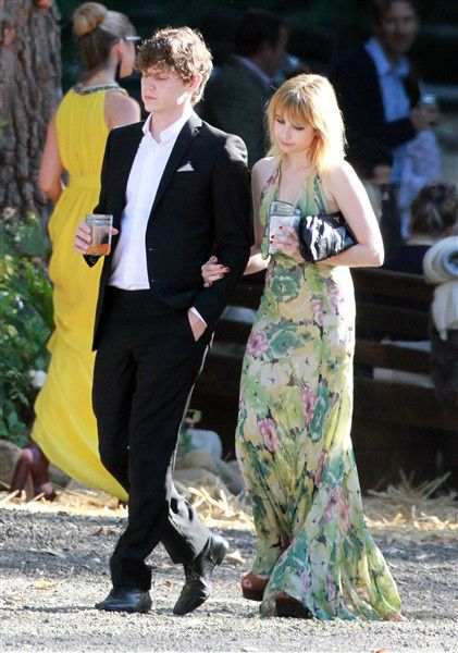 Emma Roberts and Evan Peters attend the wedding of one of her stylists in Santa Barbara, Calif., on July 14, 2012.