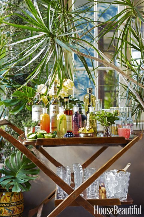 ELEVATE YOUR HOME BAR – Stock the cart with small-batch flavored simple syrups in addition to top-shelf liquors, mixers and garnishes. Then just mix and match for bartender-status drinks. Click through for tutorial and for more summer party ideas.