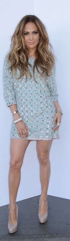 Who made  Jennifer Lopez's blue print dress and nude pumps?
