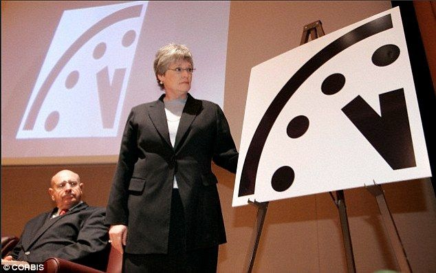 Tick tock: Here Kennette Benedict, executive director of the Bulletin of the Atomic Scientists (BAS), is shown unveiling the New Doomsday Clock during a news conference in 2007. The BAS has said it will host a live conference tomorrow to reveal the Science and Security Board's decision regarding the clock's minute hand