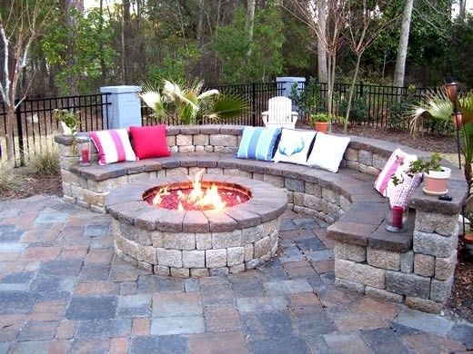 Huge fire pit seating area. I love this - but I definitely prefer the circular seating for whatever reason. And ours would obviously be for a real fire with real logs.