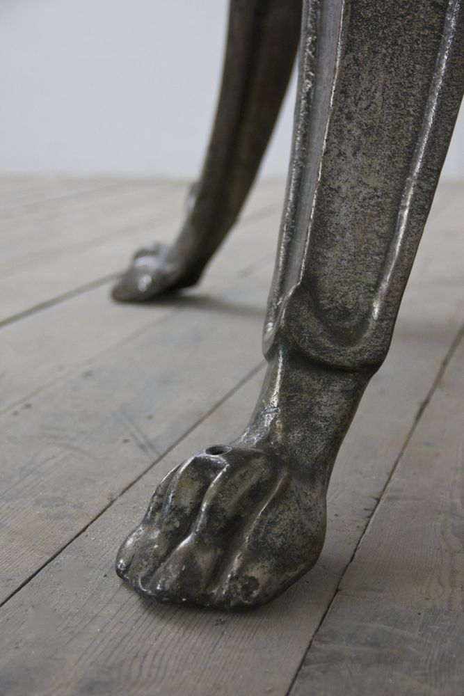 A 19th century polished iron lion's paw table. http://www.matthewcox.com