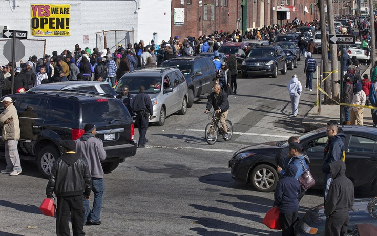 42)  People in cars and on foot line up for free gasoline in the Jamaica neighborhood of Queens, on November 3, 2012. Trucks provided by the U.S. Department of Defense at the direction of President Barack Obama at this site and others were deployed in coordination with the New York National Guard at the direction of the governor. (AP Photo/Craig Ruttle)