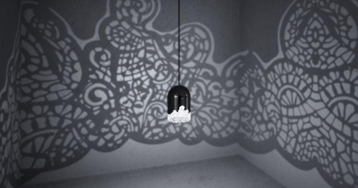 """Linlin and Pierre-Yves Jacques, a pair of designers and artists based in Paris, have created a wonderful 3D-printed lamp design that will illuminate your room with rich and elaborate lace patterns. Their Sky model hangs from the ceiling and """"laces up"""" just the walls, while the Land model stands on a tabletop and laces the ceiling and walls."""