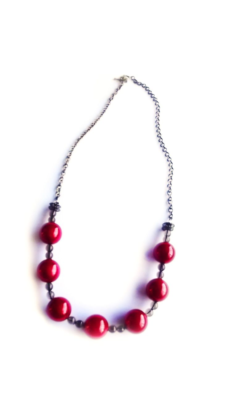 Red  and gold necklace with smokey quartz in between.  With clasp and chain.  To find prices visit website.