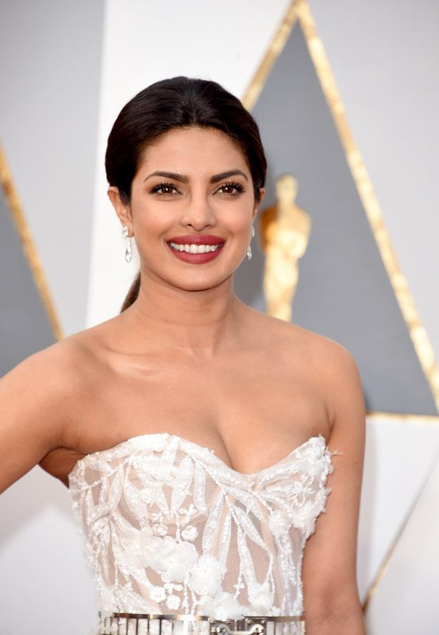 Gosh, that smile.   You'll Instantly Fall In Love With Priyanka Chopra's Oscars Outfit