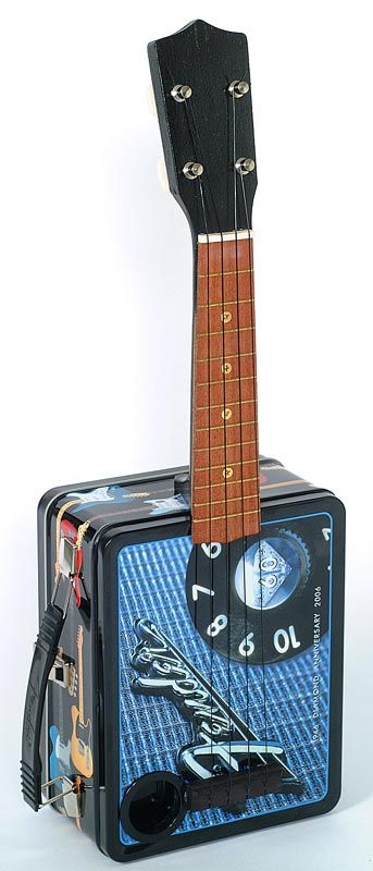 Ukulele Ray's innovative creation of the Fender® 60th Anniversary Lunchbox-A-Lele with pre-amp system and thermos amp, along with the Fender® Tweed and Bassman Lunchbox-A-Leles. All part of Ray's Fender® Lunchbox Ukulele Series.