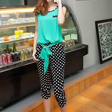 Polka dots go viral! Check out this cute sleeveless knee-length jumpsuit.