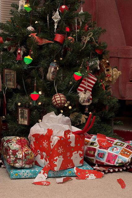 Elf on the Shelf opens gifts