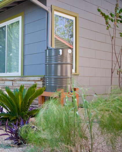 Most of the photos show rain barrels sitting on the ground, but they work best when elevated as high as possible. At grade, rain barrels produce almost no water pressure, which means a slow trickle of water from the end of your hose.