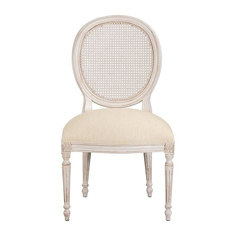 Refined without ruffles. You'll be sitting pretty on this French-inspired chair. The cane back gives the piece an air of lightness. To bring in a garden feeling, you might choose to have the cane hand-painted with a lattice pattern. With exquisite hand-detailing and double-welting.