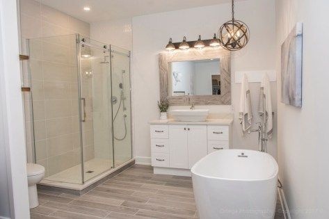 This contemporary bathroom has clean lines but also some rustic touches like the lighting and the wood grain tile - We are huge fans of the wood bead garland trend - they are a great accessory for home styling and farmhouse decor -  Home decor, home decor ideas, home styling, home styling ideas, home decor inspiration, home style