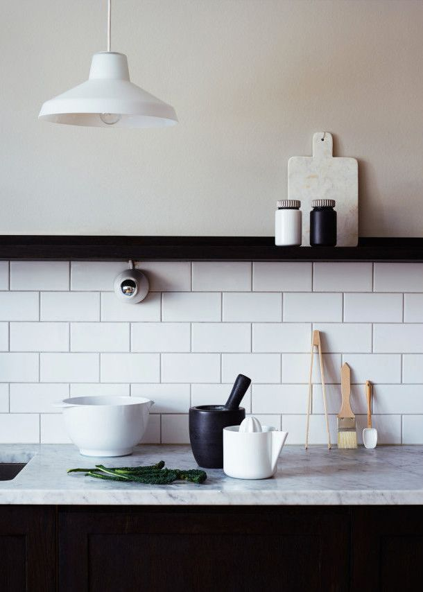 Black lowers, open uppers, halfway white subway tile.