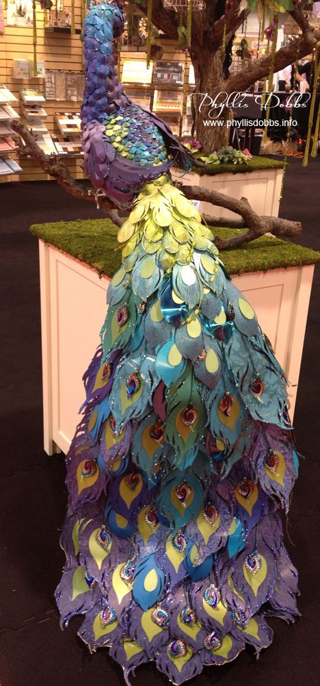 Sculptured paper peacock in the DCWV booth at CHA.  Product and display review on blog.
