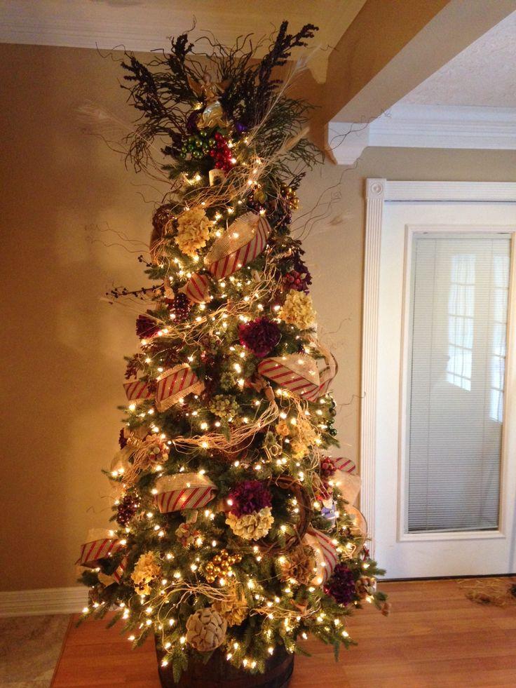 Wine Christmas; Tuscan Vineyard Christmas Theme; Whiskey Barrel; raffia, burlap, hydrangeas, Santa Clause ornaments, wine Corks, grapes, grapevine wreath