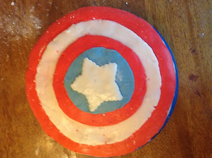 Captain America shield cake for the 4th of July. Homemade fondant made from scratch over a chocolate lover's chocolate cake.