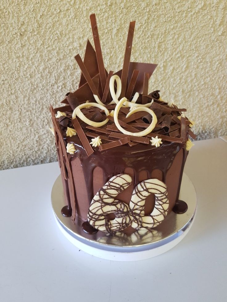 Chocolate drip cake loaded with tempered chocolate
