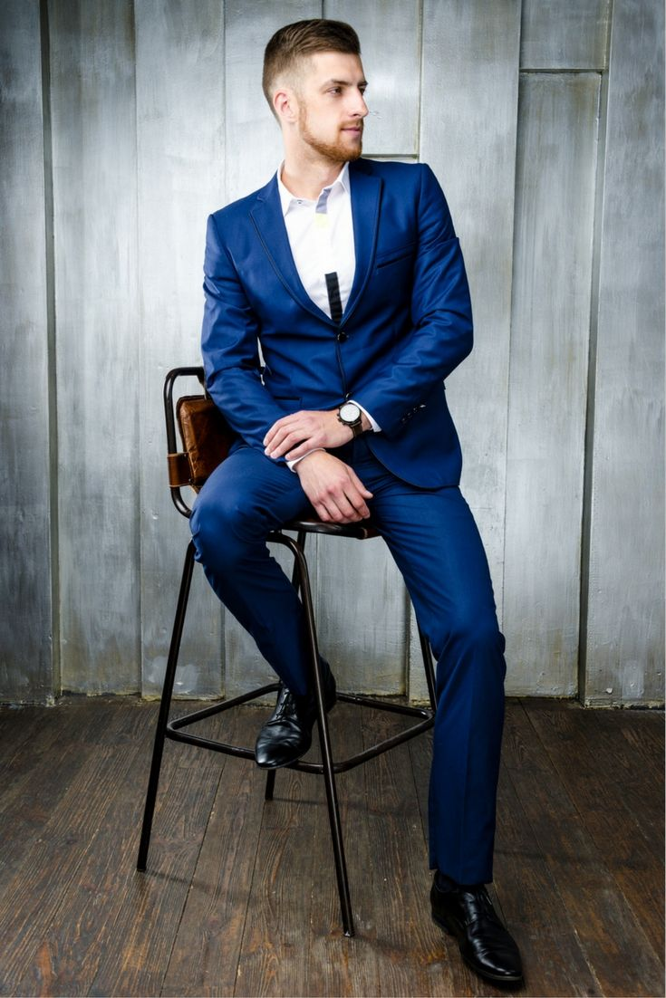 The blue suit with black shoes combo is the more