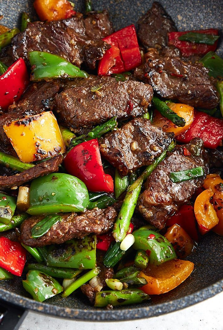 Hunan beef with peppers and asparagus. The classic spicy hunan beef dish made a little healthier with the addition of colorful bell peppers and asparagus. Serve with steamed rice and enjoy one those dishes that will make you forget about Chinese take-out forever.