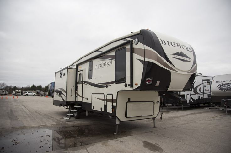 "KICK BACK AND ENJOY LIFE!!!  2017 Heartland Bighorn Traveler 31RL Experience a life of leisure in this 11,333 lb, 34' 11"" long RV! The 3 slides in this model give you ample space to move around as you enjoy the cool air created by the 15K BTU A/C! R38 roof & floor insulation ensures that the temp you set inside stays there and isn't creeping outside! Check it out! Give our Bighorn Traveler expert John Sobczak a call 231-903-6220 for pricing and more information."