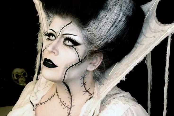 A Witch w/ Goth appeal special effects makeup idea paired with all-white FX contact lenses => http://www.pinterest.com/pin/350717889705706572/