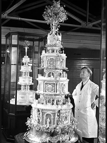 KING GEORGE VI & THE QUEEN MUM  The official wedding cake of Elizabeth Bowes-Lyon (later the Queen Mother) and then-Prince Albert, Duke of York, was put on display in Reading, England, prior to their April 26, 1923, nuptials. Hordes of onlookers queued up to vie for a view of the ornate, 10-ft. tall confection.