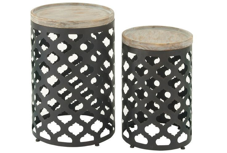 Our 2-piece Wood & Metal accent table set allows you to enjoy double the style and function. Bases crafted with metal feature cutout designs with an exotic Moroccan-inspired pattern. The wood tops add natural, durable flair, and provide plenty of space for drinks and décor.