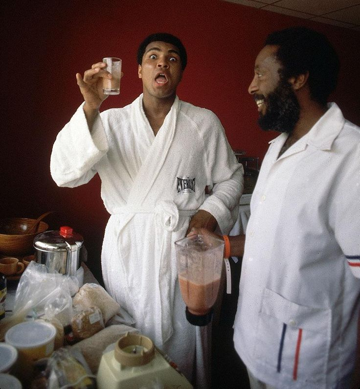 Ali holds a drinking concoction given to him by Dick Gregory, an advocate of a raw fruit and vegetable diet, in Cassius Marcellus Clay, Jr. [January 1942 ...