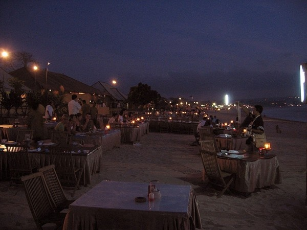 Jimbaran Bay, Bali.  Go there and have delicious grilled fish and other seafood... YUM!