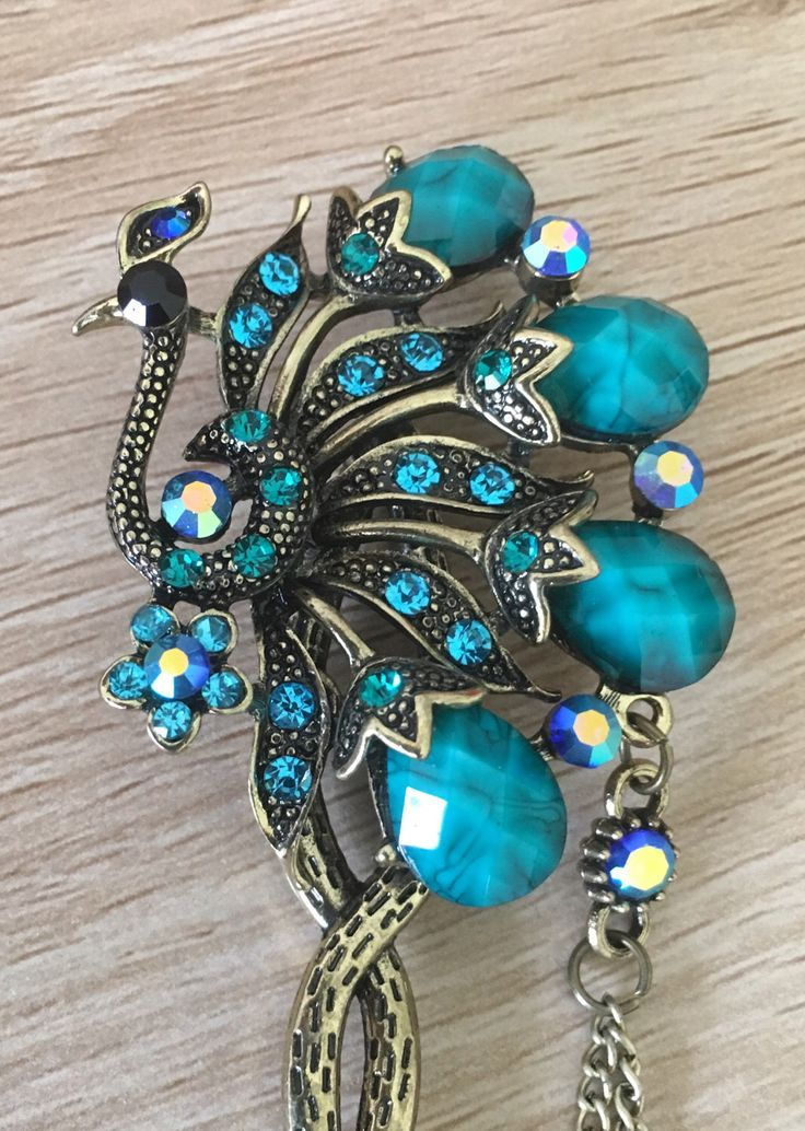 A personal favourite from my Etsy shop https://www.etsy.com/au/listing/496815028/peacock-blue-rhinestones-hair-pin-hair