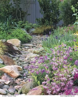 Dry Stream Does Double Duty | Fine Gardening Prettying up a french drain