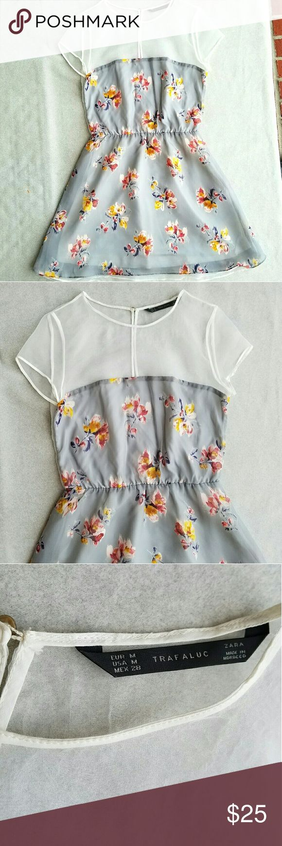 Zara Trafaluc Sheer Top Floral Dress Spring and summer dress with sheer top and back. High neck with keyhole close in back. Skirt is flowy. Cute floral pattern. Excellent condition. Zara Dresses
