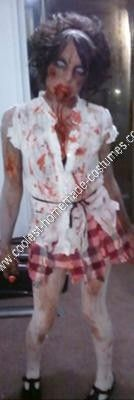 Homemade Zombie DIY Halloween Costume Idea: I took some random clothing and put together a schoolgirl outfit, shredded it, threw on some fake blood, ordered some funky contacts, and used eyeshadow
