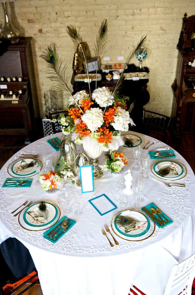 white orange wedding decor with turquoise accents wedding table: Tables, Brunches, Massive Peacocks, Orange Weddings, White Weddings, Accent Decor, Dark Blue, Turquoise Weddings, Peacocks Feathers