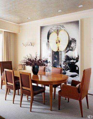 At the Manhattan townhouse of designer Marc Jacobs, an Urs Fischer artwork makes a dramatic contrast to the dining room's Jacques Quinet table and chairs from Bernd Goeckler Antiques. The alabaster sconces are by Pierre Chareau | Inspiration for creative minds