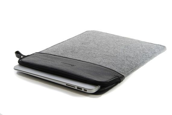 PU Leather and wool felt sleeve for 13 Inch laptop.   Practical design and exquisite workmanship; Environmentally friendly material. Sustainable, renewable and biodegradable. Your Mac/PC goes where you go. Now it can travel in sleek, protected style with this SettonBrothers 13-inch felt laptop sleeve. Designed for 13-inch laptops including MacBook Pro Retina or 13-inch MacBook Air laptop, the savvy sleeve can also be used with most Ultrabook or MacBook laptops. Use the laptop sleeve as a...