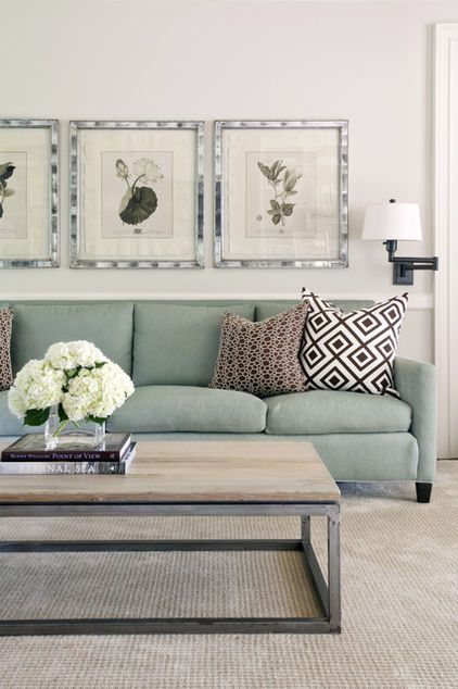 mint sofa, wood coffee table, and floral prints