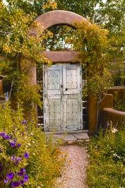 The entrance to painter James Havard's Santa Fe gardens showcases the artfulness of nature.   Photography By Daniel Nadelbach and Gilda Meyer-Niehof