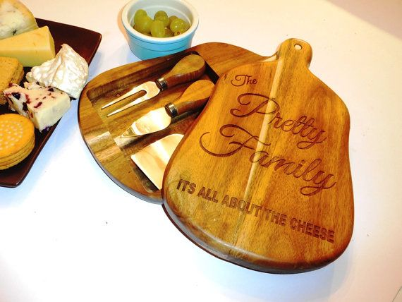 Rustic Cheese Board and 3 Knives  This is a lovely laser engraved cheese board.  I design each board up to customers requirements with any personalisation you want. I send a few proofs first to make sure you are happy with the font and layout. I send a few choices. Once you are happy, then i will engrave it and send it off to you. The board comes with 3 cheese knives which are in the Acacia Wooden board. Makes a lovely gift for someone special in your lives. They are all make with love at…