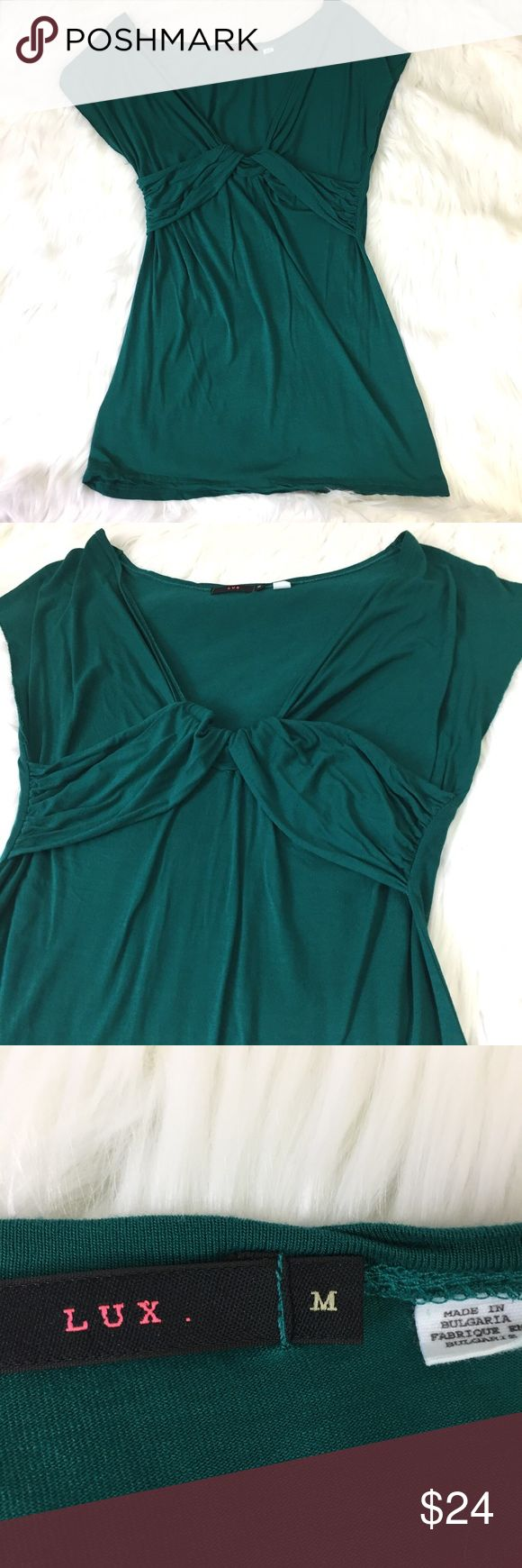 "Anthropologie lux viscose emerald green tee size M Figure flattering viscose tee by Lux for Anthropologie size M.  Approximate flat lay measurements: armpit to armpit 15.5"", center of neckline to hem 21"".  Unfinished edge sleeves, draping under bustling. Anthropologie Tops Tees - Short Sleeve"
