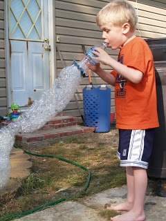 Snake bubbles. Water bottle cut off bottom. Put thin washcloth over hole with rubberband. Dip into bowl of dish soap and water. Blow